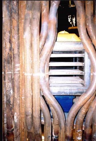 На фото 1. показаны ГУ СНТ на котле ПТВМ-30.  Горелки разжигаются при давлении 1-3 мм в.ст., на всех 6-ти горелках...